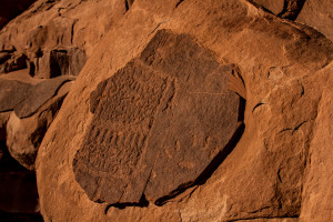 A looter attempted to cut this petroglyph out of a cliff with a  rock saw and chisel